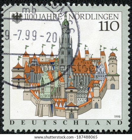 GERMANY - CIRCA 1998: A stamp printed in German Federal Republic honoring 1100 anniversary of Nordlingen - town in the Donau-Ries district, in Bavaria, circa 1998