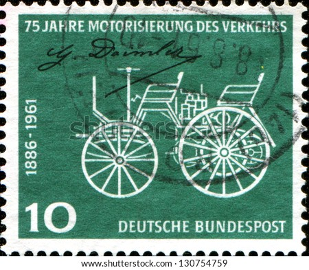 GERMANY - CIRCA 1961: A stamp printed in German Federal Republic honoring 75th Anniv of Daimler-Benz Patent, shows Early Daimler Motor Car, circa 1961 - stock photo