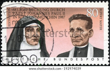 GERMANY - CIRCA 1988: A stamp printed in German Federal Republic shows Beatification of Edith Stein and Rupert Mayer by Pope John Paul II in 198, circa 1988 - stock photo