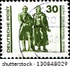 GERMANY - CIRCA 1990: A stamp printed in German Federal Republic shows Monument of Johann Wolfgang von Goethe and Johann Christoph Friedrich von Schiller, circa 1990 - stock photo