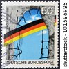 GERMANY - CIRCA 1990: A stamp printed in Germany dedicated to the first anniversary of the fall of the Berlin Wall, circa 1990 - stock photo