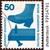 """GERMANY - CIRCA 1971: A stamp printed in Germany from the """"Accident Prevention"""" issue shows a protruding nail in plank, circa 1971. - stock photo"""