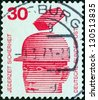 """GERMANY - CIRCA 1971: A stamp printed in Germany from the """"Accident Prevention"""" issue shows falling brick and protective helmet, circa 1971. - stock photo"""
