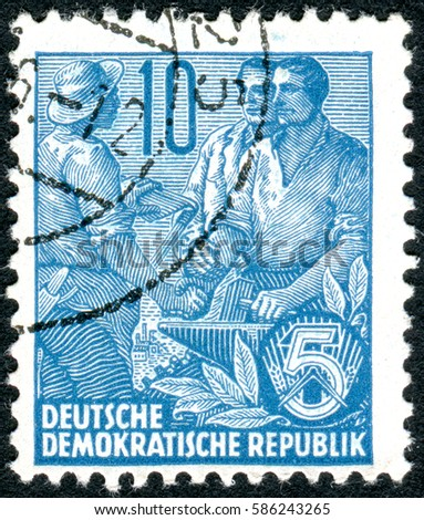 GERMANY - CIRCA 1955: A stamp printed in Germany (GDR), is dedicated to the five-year plan, shows worker, peasant and intellectual, circa 1955