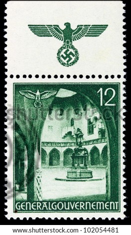 GERMANY - CIRCA 1940: A stamp printed in Germany showing buildings of Poland (Yard of the Old Krakow University with Copernicus Monument) , circa 1940 - stock photo