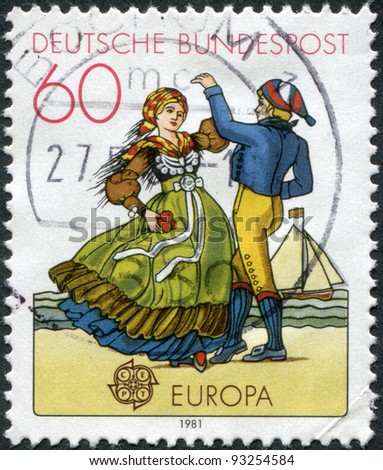 GERMANY - CIRCA 1981: A stamp printed in Germany, shows a Northern couple, circa 1981 - stock photo