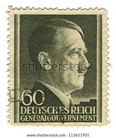 GERMANY - CIRCA 1943: A stamp printed in Germany shows image of Adolf Hitler was an Austrian-born German politician and the leader of the Nazi Party, in black, circa 1943. - stock photo