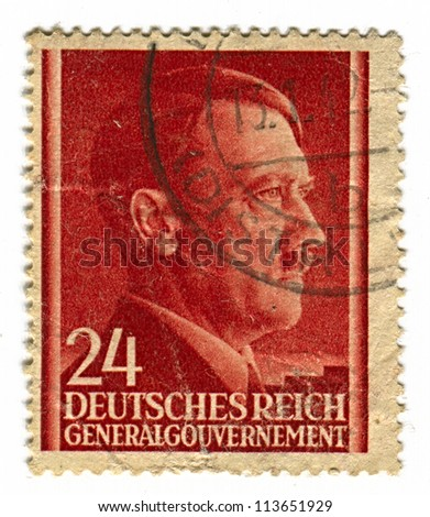 GERMANY - CIRCA 1943: A stamp printed in Germany shows image of Adolf Hitler was an Austrian-born German politician and the leader of the Nazi Party, in red, circa 1943. - stock photo