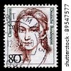 GERMANY-CIRCA 1986:A stamp printed in Germany shows image of Clara Schumann was a German musician and composer, considered one of the most distinguished pianists of the Romantic era, circa 1986. - stock photo