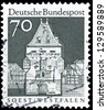 """GERMANY - CIRCA 1966: A stamp printed in Germany shows Osthofen Gate, Soest, North Rhine-Westphalia, with the same inscription, from the series """"Historic Buildings"""", circa 1966 - stock photo"""