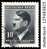"GERMANY - CIRCA 1937: A stamp printed in Germany shows Portrait of Adolf Hitler (Nazi war criminal and former leader of the Nazi Party), without inscription, from the series ""Adolf Hitler"", circa 1937 - stock photo"