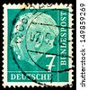 GERMANY - CIRCA 1954: A stamp printed in Germany, shows portrait of Theodor Heuss a liberal German politician and first President of the FRG, circa 1954   - stock photo