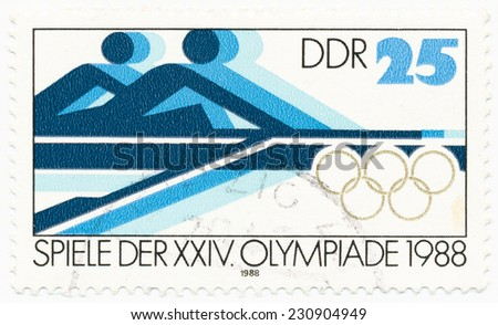 GERMANY - CIRCA 1988: A stamp printed in Germany shows symbolic image of rowers, circa 1988 - stock photo