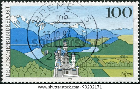 GERMANY - CIRCA 1994: A stamp printed in Germany, shows the Bavarian Alps and the Neuschwanstein Castle, circa 1994 - stock photo