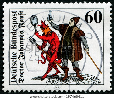 GERMANY - CIRCA 1979: A stamp printed in Germany, shows the Doctor Johannes Faust with Homunculus, Mephistopheles and Faust, Woodcut (1616), circa 1979 - stock photo