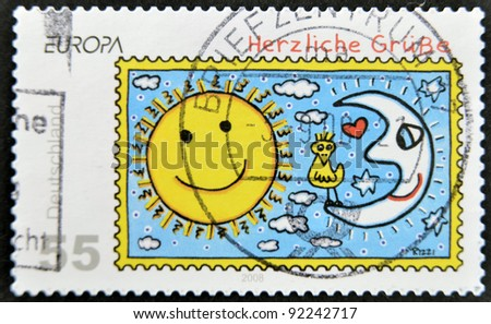 GERMANY - CIRCA 2008: A stamp printed in Germany shows the sun and the moon with the birds, circa 2008