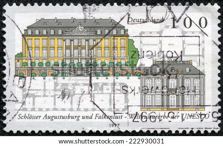 GERMANY - CIRCA 1997: a stamp printed in the Germany shows Augustusburg and Falkenlust Castles, Bruhl, UNESCO World Heritage Sites, circa 1997 - stock photo
