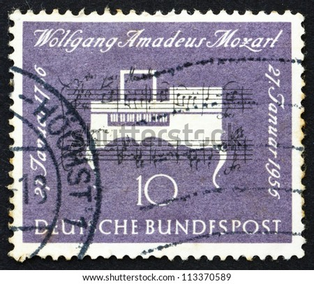 GERMANY - CIRCA 1956: a stamp printed in the Germany shows Clavichord, 200th Anniversary of the Birth of Wolfgang Amadeus Mozart, Composer, circa 1956 - stock photo
