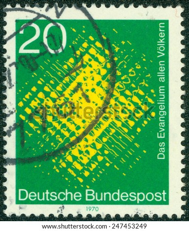 GERMANY - CIRCA 1970: a stamp printed in the Germany shows Cross Seen through Glass, for the world mission of Catholic missionaries, circa 1970 - stock photo