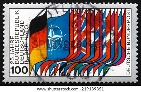 GERMANY - CIRCA 1980: a stamp printed in the Germany shows Flags of NATO and Members, Germany's Membership in NATO, 25th Anniversary, circa 1980 - stock photo