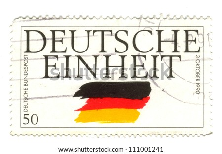 GERMANY - CIRCA 1995: a stamp printed in the Germany shows German Flag, German Reunification, circa 1995 - stock photo