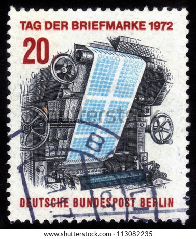 GERMANY - CIRCA 1972: a stamp printed in the Germany shows Image printing press, printing postage stamps, circa 1972 - stock photo