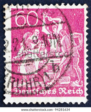 GERMANY - CIRCA 1921: a stamp printed in the Germany shows Iron Workers, circa 1921