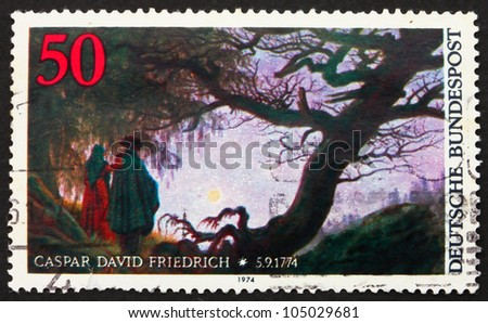 GERMANY - CIRCA 1974: a stamp printed in the Germany shows Man and Woman Looking at the Moon, by Caspar David Friedrich, circa 1974