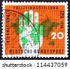 GERMANY - CIRCA 1956: a stamp printed in the Germany shows Map of the World and Policeman'??s Hand, International Police Show, Essen, circa 1956 - stock photo