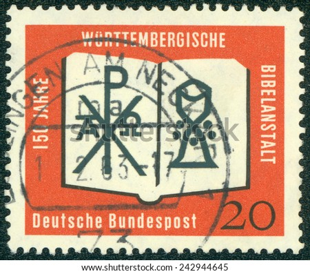 GERMANY - CIRCA 1962: a stamp printed in the Germany shows Open Bible, Chrismon and Chalice, 150th Anniversary of Wurttemberg Bible Society, circa 1962 - stock photo