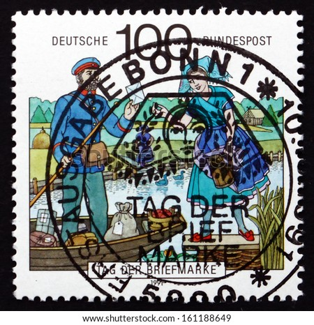 GERMANY - CIRCA 1991: a stamp printed in the Germany shows Postman, Spreewald Region, Stamp Day, circa 1991 - stock photo