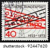 GERMANY - CIRCA 1973: a stamp printed in the Germany shows Radio Tower and Word Interpol, 50th anniversary of International Criminal Police Organization, circa 1973 - stock photo
