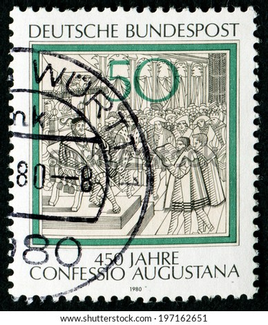 GERMANY - CIRCA 1980: a stamp printed in the Germany shows Reading of Confession of Augsburg to Charles V, Engraving, 450th anniversary, circa 1980 - stock photo