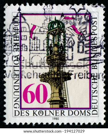 GERMANY - CIRCA 1980: a stamp printed in the Germany shows Setting Final Stone in South Tower, Completion of Cologne Cathedral, Centenary, circa 1980 - stock photo