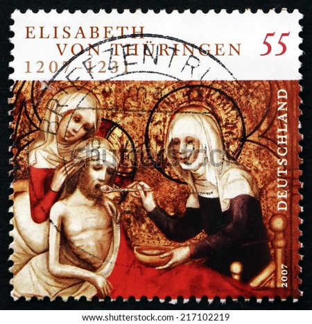 GERMANY - CIRCA 2007: a stamp printed in the Germany shows St. Elizabeth of Hungary, greatly Venerated Catholic Saint, circa 2007 - stock photo