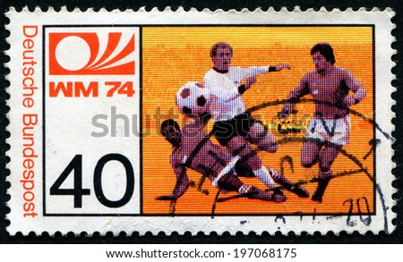 GERMANY - CIRCA 1974: a stamp printed in the Germany shows Three Soccer Players, World Cup Soccer Championship, Munich, circa 1974 - stock photo