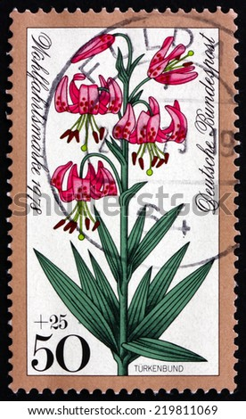 GERMANY - CIRCA 1978: a stamp printed in the Germany shows Turk's Cap Lily, Lilium Superbum, Alpine Flower, circa 1978 - stock photo