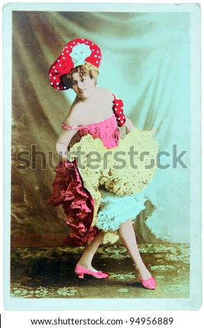 GERMANY - CIRCA 1900: A vintage postcard printed in GERMANY shows hand painted photograph of beautiful lady in fashion dress of 1900. Circa 1900. - stock photo