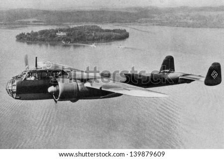 GERMANY - CIRCA 1940: Dornier Do 17 bomber in flight over lake on German war postcard. Dornier 17 was Luftwaffe light bomber fighting in Battle of Britain during second world war. Germany, circa 1940. - stock photo