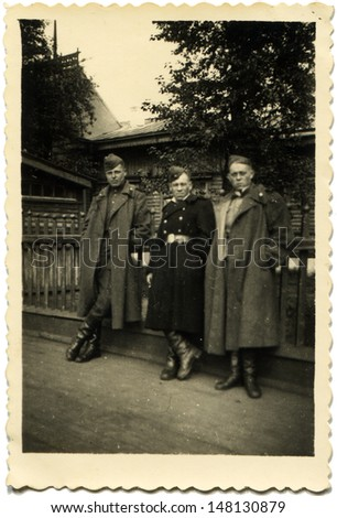 GERMANY - CIRCA end of 1940s: Vintage photo shows three soviet soldiers, Germany, 1940s