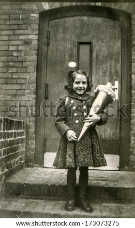 "GERMANY, CIRCA FIFTIES - Vintage photo of little girl with ""Schultute"" or School Cone, sweets for the first day in school"