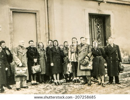 GERMANY, CIRCA FORTIES - A big group of people outdoor