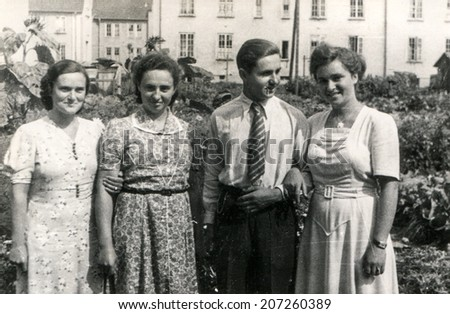 GERMANY, CIRCA FORTIES - Vintage photo of man and three women outdoor