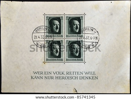 GERMANY - CIRCA 1937 - 4 German canceled stamps - sheet - show portrait of Adolf Hitler, German Reich, circa 1937 - stock photo