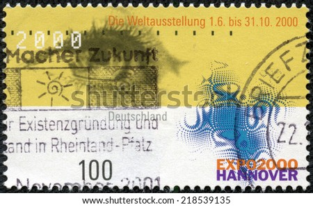 GERMANY - CIRCA 2000: Postage stamp printed in Germany, dedicated to the EXPO 2000, Hannover, depicts the eye and emblem, circa 2000 - stock photo