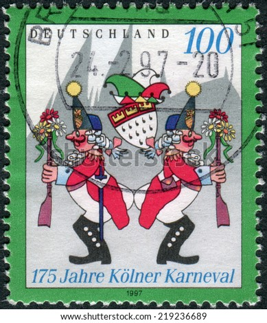 "GERMANY - CIRCA 1997: Postage stamp printed in Germany, dedicated to the 175th anniversary of the Cologne Carnival, shows Carnivalists at the ""Wibbeln"", circa 1997"