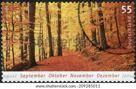 GERMANY - CIRCA 2006: Postage stamp printed in Germany, shows autumn landscape, forest, circa 2006  - stock photo