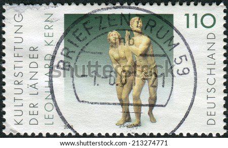 GERMANY - CIRCA 2000: Postage stamp printed in Germany, shows The Expulsion from Paradise, sculpture by Leonhard Kern, circa 2000  - stock photo