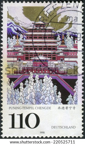 GERMANY - CIRCA 1998: Postage stamp printed in Germany, UNESCO World Heritage Sites, depicted Puning Temple, Chengde, People's Republic of China, circa 1998  - stock photo