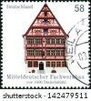 GERMANY - CIRCA 2012: Postage stamps printed in Germany, shows a half-timbered building in central Germany, Dinkelsbuhl, circa 2012 - stock photo